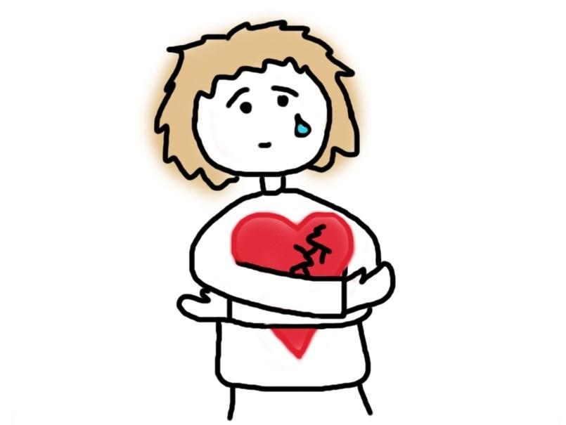 Trauriger Mensch hält verletztes Herz im Arm