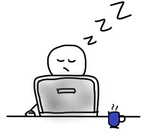 Mann sitzt müde am Laptop